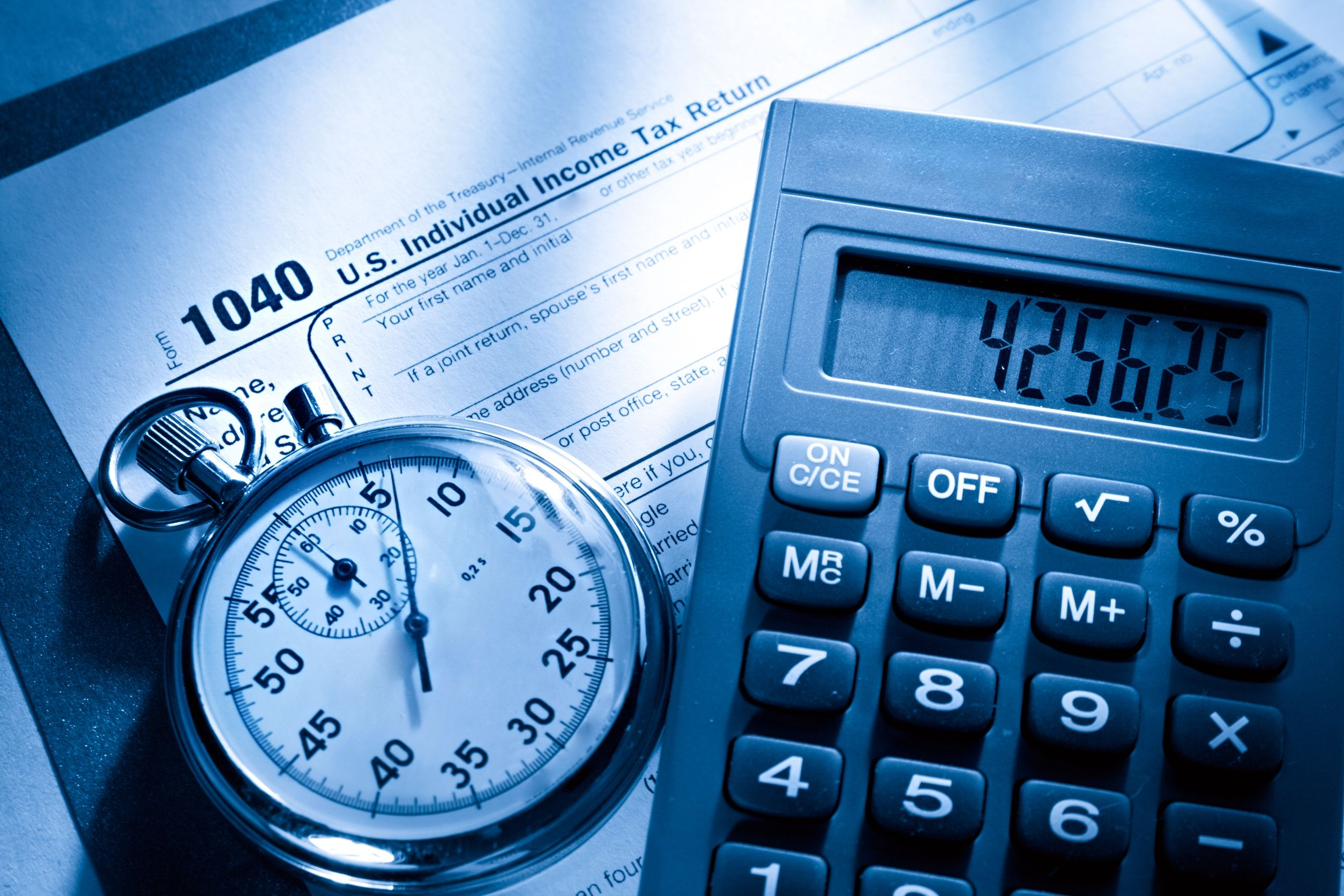 11759976 - tax form, stopwatch and calculator